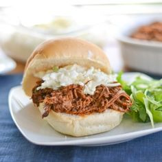 Pulled pork made with a slow cooker / crock-pot. Melt-in-your-mouth delicious!