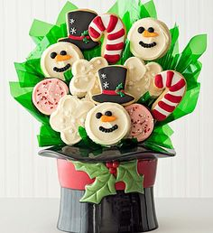 Ceramic Snowman Hat Cookie Flower Pot  | Cookie Flowers | Cheryls.com | Desserts today, poinsettias tomorrow! The Cheryl's Snowman Hat Cookie Flower Pot features a ceramic snowman cookie jar and some of our favorite buttercream frosted cutouts.