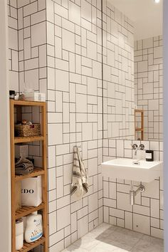 Geometric patterns with rectangular and square wall tiles in white with black grout