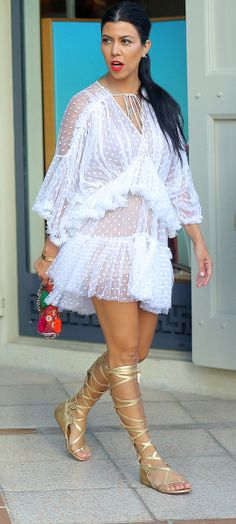 Kourtney Kardashian is a vision in white in St. Barts on Aug. 17