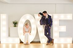 Light up LOVE Letters | Esme Jenny Packham Wedding Dress | Stoke Place | Pink, White & Metallic Colour Scheme | Frances Sales Photography | http://www.rockmywedding.co.uk/jo-alex/