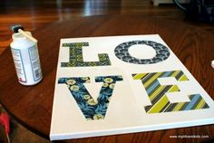 Homemade LOVE canvas with mod podge and scrap booking paper!  love it!!!