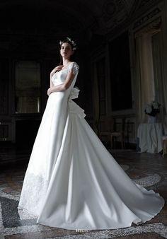 Collezione EP 2015 - Elisabetta Polignano: seta bianca con morbido fiocco #wedding #weddingdress #weddinggown #abitodasposa