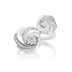 Aria Toi Et Moi Ring  Featuring two centre diamonds, the Aria Toi et Moi Ring heroes the unifying choreography of light through the delicately spiralling layers of pavé diamonds.