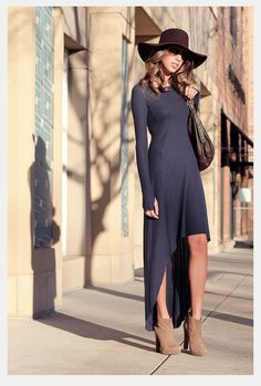 Love that long navy dress and her stylish boots.  Ohhhh that hat is so cute too.