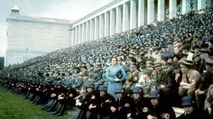 Thousands of spectators and Wermacht troops sit at the Zeppelinfeld, Germany - 1930's