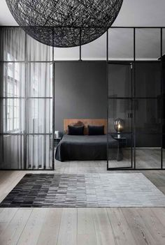 Dark walls working well with light floors, ceiling and large windows