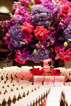 Pink & Purple Flowers with Escort Cards | Photo: Averyhouse. View More:  http://www.insideweddings.com/weddings/catholic-ceremony-tented-reception-with-vibrant-color-palette/924/
