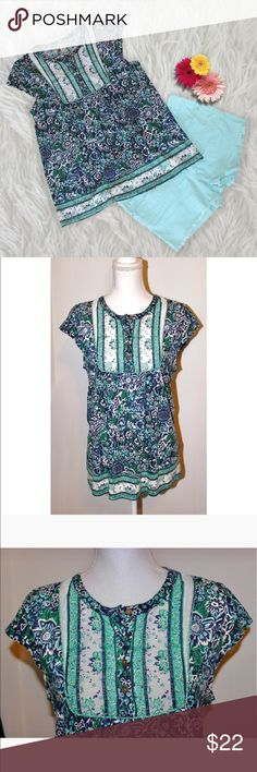 """Floral Lucky Brand Blouse This top is just adorable! About it:  * Floral patterned * Cap sleeves * Slight fit and flare * Stretchy * 60% cotton and 40% modal  MEASUREMENTS:  * Armpit to pit 18.5"""" * Waist 39"""" * Hips 41"""" * Length from back of neck 26.5"""" * 4 silver buttons on neck This top is by Lucky Brand, is in excellent condition- no flaws, and is size Medium. Lucky Brand Tops Blouses"""