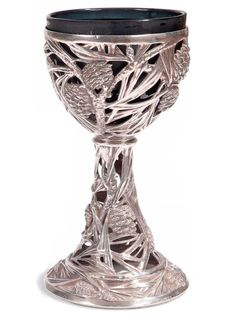 Pinecone Goblet. Rene Lalique (1860 - 1945). Circa 1902. Silver, glass. At least 36 of these were made, with a variety of different coloured opalescent glass blown into the silver base. The piece pictured here has what appears to be a contemporary bowl inserted; pictures of other goblets have glass in the base also.