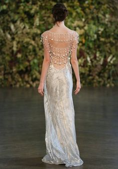 This Atelier Couture gown is one of Claire's most inspired creations. Ornate facades, and intricate carvings are interpreted into French lace and silk embroi...