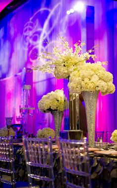 Mirror and silver centerpieces from Jared and Lana Cook's Georgia Aquarium wedding. Wedding Planned & Design by Tiffany Cook Events.
