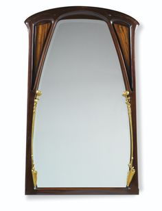 AUX NÉNUPHARS', A MAHOGANY AND GILT BRONZE MIRROR BY LOUIS MAJORELLE, CIRCA 1900