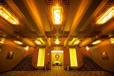 Paramount Theater - Details of the lower level lounge with the stairs going up to the main corridor, and elaborate ceiling decorations.