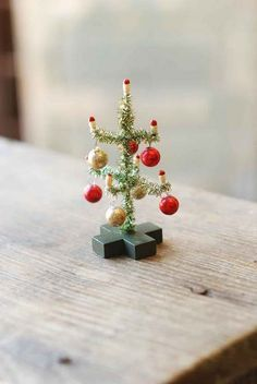 """- Tiny Christmas Tree. Perfect for small Christmas vignettes. - 4-1/2"""" tall. - Tinsel, glass, wire, resin. - Imported."""