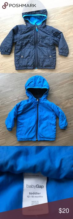 Gap Toddler Reversible Rain Repellant Jacket 12-18 Baby Gap reversible blue tone jacket.  12-18 Months. 2 pockets on each side.  Quilted. Hooded. Water repellant. Great for cold and rainy weather.  Love this because it's warm for your little one yet not too bulky.  Get two looks in one jacket.  Preowned and in great condition. GAP Jackets & Coats Raincoats