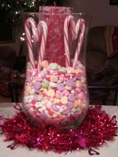 I super glued a few of the the candy canes hearts I made to a sparkly candle I bought after Christmas from Hobby Lobby, then added some Valentine's Day candy hearts to the hurricane vase to make a unique but Valentine spirited arrangement for on top of the bar.