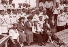 Tsar Nicholas II with his children surrounded by sailors and Naval officers.
