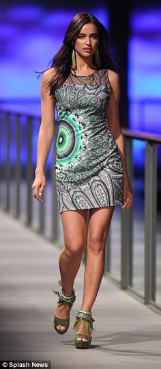 Body beautiful: Irina looked effortlessly chic as she sashayed down the catwalk while showing off her toned legs