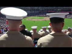 Sgt. Maj. of the Marine Corps Micheal P. Barretts throws the first pitch in honor of wounded warriors at Marine Corps Day at Nationals Park.