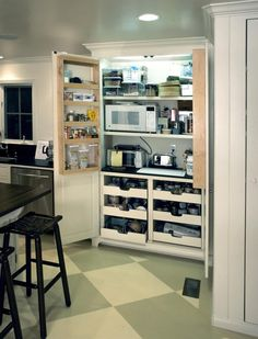 """Now would you look at THAT!! A BRILLIANT way to store all those counter top items AND a lot of other misc needed """"stuff"""" out of being an eyesore...maybe a cupboard 1/2 this size built into the tiny house would be just right!"""