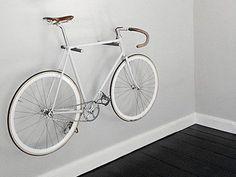 Bicycle wheel, Bicycle, Bicycle part, Bicycle handlebar, Bicycle frame, Bicycle saddle, White, Bicycle tire, Bicycle stem, Bicycle accessory, Bicycle Hanger, Bike Hooks, Bike Shelf, Bike Rack, Bike Wall Mount, Range Velo, Bicycle Tires, Bicycle Wheel, Bike Storage