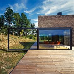 A traditional, straw-roofed cottage in Zagorje, Croatia, has been given a visually compelling contemporary spin, thanks to a glass cube extension and imaginatively-designed glass door. by Croatian architectural firm PROARCH