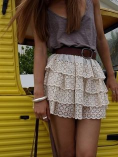 This outfit is very modern and chic. It's doily-esce print is cute easy to find. Forever21 & other stores like wet seal carry skirts like this. Ahdorable! <3