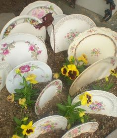 I love plates in the garden.  I made a plate border for my summer garden.  Now I have cream pitchers for my fall border.