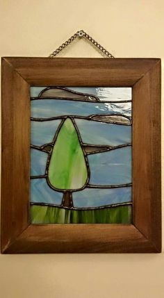 Framed glass wall art with tree