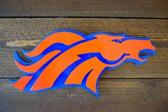 Custom Broncos 3D Art Sign, Denver Broncos 3D Sign, Metal Broncos Sign, Metal NFL Art silhouette offers a dramatic presence to any room. Offering distinct and dramatic detail that is sure to bring compliments. Our Steel products are meant to last and be durable through life and its happenings. Each item is hand crafted and make to meet your individual needs. Our products are hand made in the Flathead Valley of Montana.  DETAILS YOULL APPRECIATE * Dimensions: Roughly 17 x 5.5 (Vary In Size)…