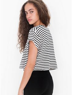 Striped Loose Crop Tee Brand new A loose-fitting striped cropped T-shirt in ultra-soft Cotton. Perfect for layering or paired with high-waist skirts, pants and shorts. Milk Duds, American Apparel Tops, Friend Outfits, Black White Stripes, Crop Tee, High Waisted Skirt, Fashion Design, Fashion Tips, Tees