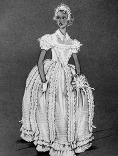 This is the design for the dress to be worn by Princess Anne and seven other bridesmaid's at the wedding of Princess Margaret and Antony Armstrong-Jones, designed by Norman Hartnell