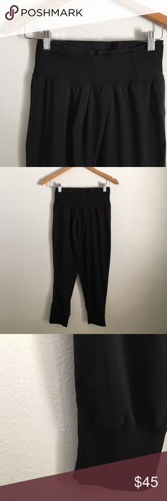 Lululemon Crop Harem Pants Very good condition, never worn (by me - re-poshing!)  Features a double waistband with crossover in front. Lightweight luxtreme feels silky smooth.  Very rare! Lulu doesn't make harem pants anymore. Great comfy buy for lounging, yoga or dance! 🤸🏻♀️  (Filter added on picture in attempt to highlight the overlapping of fabric on front of pant)  Color:: black lululemon athletica Pants