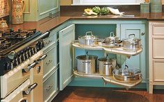 Storage idea: Two adjustable pull-out shelves that snake out and to the side in one fluid motion eliminate the need to reach inside cabinets for cookware. Häfele Arena Plus Corner Pull-out Shelf, $790; kitchensource.com
