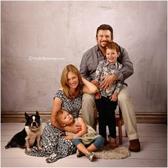 Modern family portrait in the studio with puppy boston terrier dog