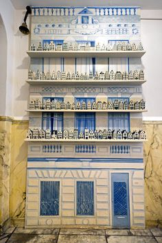 miniature replicas of Dutch canal houses in Delft blue pottery
