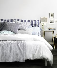 Bed with blue and white linens | A gallery of simple ideas to make your slumber zone dreamy.
