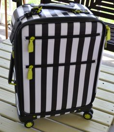 Alice and Olivia!! Cute White and Black Striped Luggage Carry-on with spinning wheels and bonus bags inside.   My daughter uses one of these for school to tote around all her dang books! Was a birthday gift.