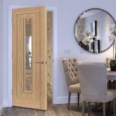 Laminates Hudson Oak Coloured Door with Clear Safety Glass is Prefinished - Lifestyle Image.    #glazeddoor #oakdoor