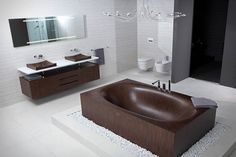 Alegna Wooden Bathtubs: Thanks to the ergonomic design of the Laguna range of bathtubs, one can enjoy a relaxing bath alone or in company. The highly resistant special varnish has been tested under the hardest conditions. It guarantees optimal protection and ensures that the wooden bathtub will have a very long service life. As a result of the modular form of construction, our wooden bathtubs can be supplied in different forms of execution.
