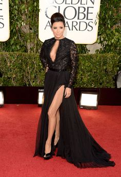 Golden Globes 2013: Eva Longoria in Emilio Pucci; It's either a plunging neckline or a Joliesque pose, Eva. Not both. Both I, dare we say, a little Desperate Housewives-ish. With that hair and that dress, we almost mistook you for Kim Kardashian. Not a good look