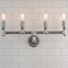 Quadruple Light Industrial Pipe Vanity Light This bold bath light is made of heavy cast iron pipe finished in Weathered Zinc for a simple industrial look that's sure to attract attention. Industrial Vanity Light, Industrial Bathroom Lighting, Bathroom Sconce Lighting, Industrial Wall Lights, Industrial Pipe, Industrial Design, Bathroom Lamps, Boy Bathroom, Bathroom Baskets