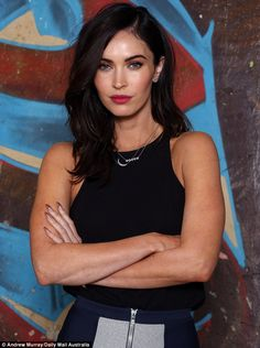 Punchy look: The 28-year-old paired her figure-hugging pencil skirt and black top with bright pink lipstick