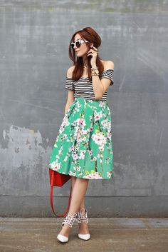 Spring time wearing my new floral midi skirt. Also wearing a pop of colour with a red mini bag and mix of prints: stripes + floral.