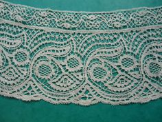 This attractive Bedfordshire edging is dated to the 19th Century.  It is slightly curved and is made up of two pieces -  a wide edging and a narrow insertion.  They might have been joined to make a wider piece of lace or possibly so that if it was used on more than one garment, the more expensive wide piece was protected from damage as the sewing stitches were unpicked.  It is made in white cotton thread and is in good condition.   Purchased for the collection. Catalogue: GF.41.2011