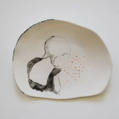 """""""Thought"""" by Anna Scheen. """"The quiet Monday Brooch/wall"""" by Anna Scheen. Designed to wear as a brooch but equally lovely placed on a hook in the wall and displayed as a small painting when it's not being worn. Hand formed southern ice porcelain, organic in shape and hand painted with a one-off design. The Brooch back is formed using stainless steel."""
