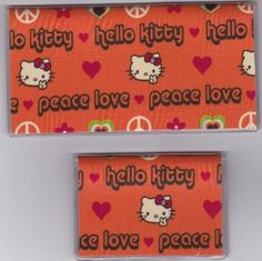 """Sanrio Hello Kitty Peace and Love Orange Checkbook Cover Set by Tickled Pink Boutique. $9.50. Fun and functional for every day use without paying a designer price for a designer name!  The sturdy clear PLASTIC 12 gauge lightweight VINYL COVER encases a fabric bonded design. Measuring 6 1/4"""" x 3 1/4"""",  the checkbook cover fits all standard bank checkbooks and banking registers.  All checkbook covers come with a register flap and a duplicate check flap just like..."""