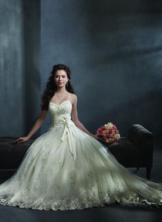 Style #2300    Net, Satin, Embroidered Lace with Metallic Accents  Crystal Beading, Sequins Rhinestones  Satin & Organza Flowers, Organza Ribbon  Chapel Train