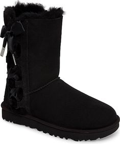 UGGR Women's Shoes in Black Suede Color. Satin ribbons lace up the side of a supremely cozy boot featuring a plush lining made from genuine shearling and signature UGGpure, a textile made entirely from wool but shaped to feel and wear like genuine shearling.